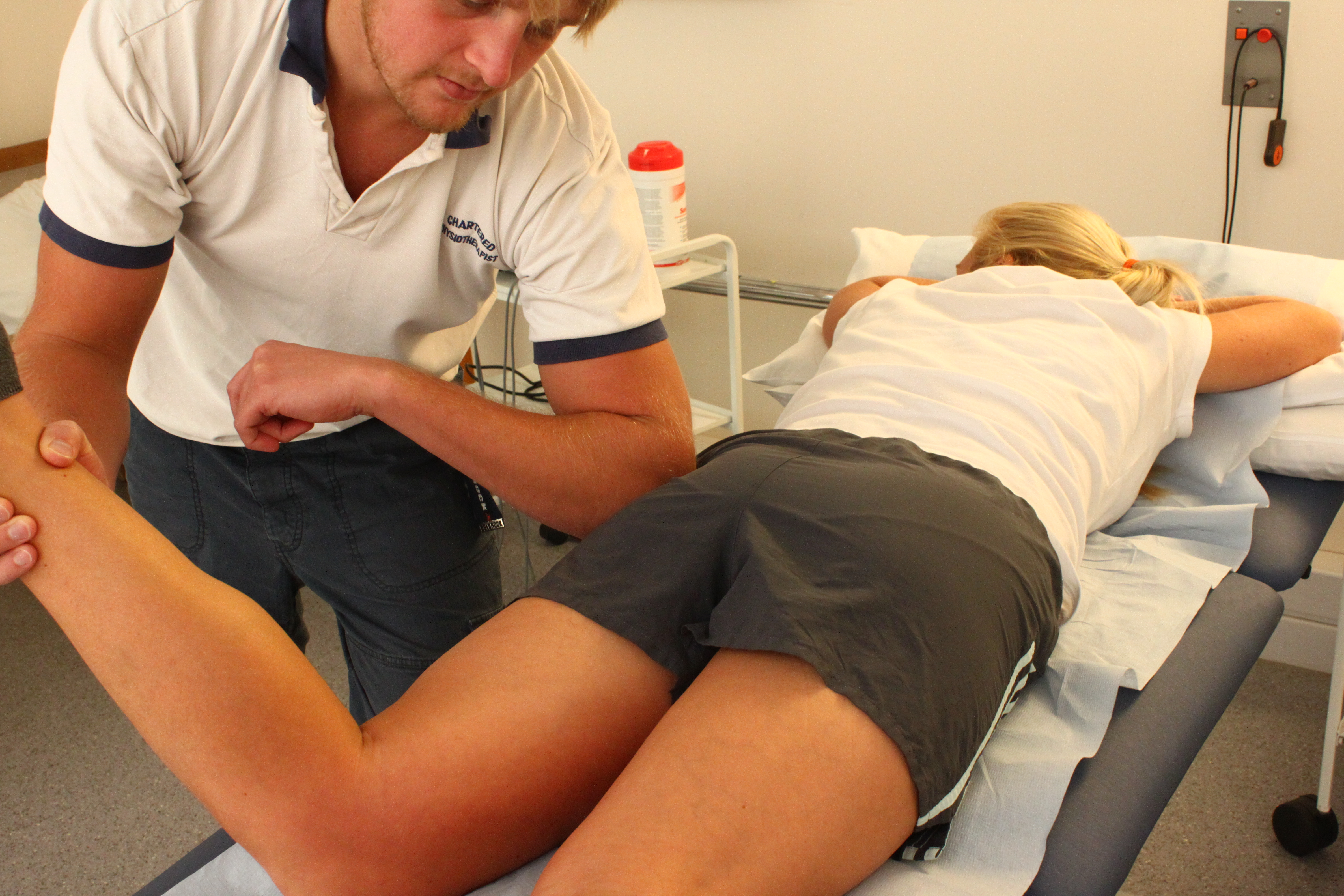 © Lewes Physiotherapy Clinic. Physiotherapist using a therapy